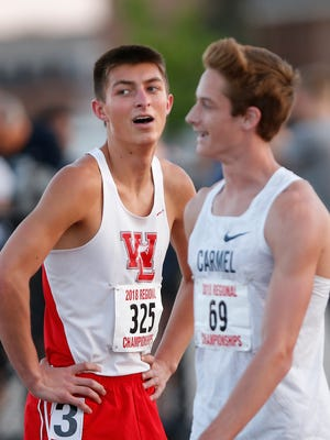 Mitchell Curl, left, of West Lafayette smiles after finishing second in the 800 meter run during the boys track and field regional Thursday, May 24, 2018, at Lafayette Jeff. Curl's time was 1:55.99.