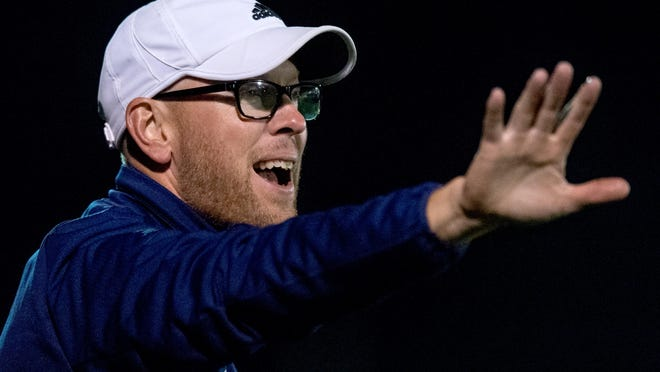Notre Dame boys soccer coach Mike Bare directs his team against Cleveland St. Ignatius on Friday, Oct. 4, 2019 at Peoria Notre Dame High School.