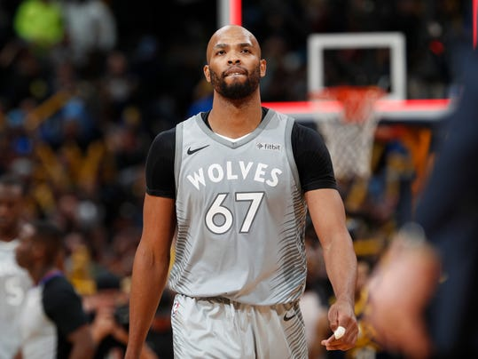 Minnesota Timberwolves forward Taj Gibson reacts as time runs out in the second half of the team's NBA basketball game against the Denver Nuggets on Thursday, April 5, 2018, in Denver. The Nuggets won 100-96. (AP Photo/David Zalubowski)