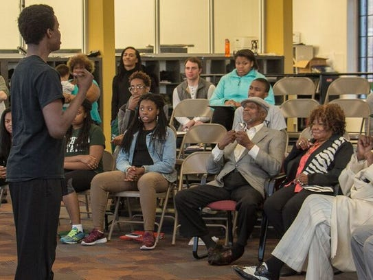 Mosaic's D'Marreon Alexander sings for a group that
