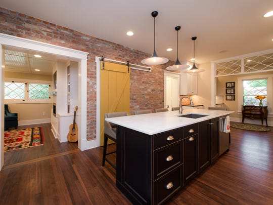 In the remodel, walls were removed and walkways widened to create an open, functional and inviting floor plan.