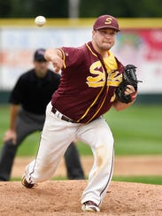 Sobieski pitcher Tyler Jendro delivers the ball to