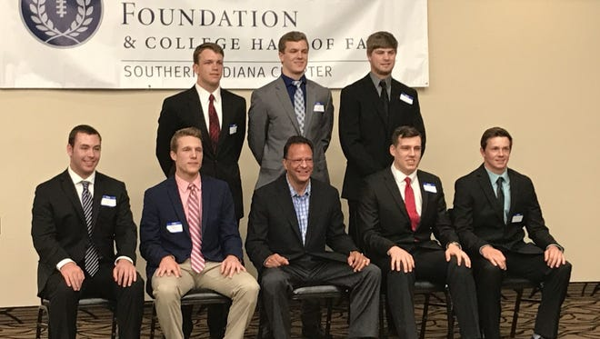 Southern Indiana high school football players and former Indiana basketball coach Tom Crean pose for pictures before the 2017 Scholar-Athlete Banquet Sunday night at St. Mary's Hospital Manor. Front row (L-R): Dalton Wash, Freddie Coudret, Tom Crean, Reid Mahan, Trevor Clark. Back row (L-R): Kurtis Wilderman, Neal Hayhurst, Jackson Ashby.