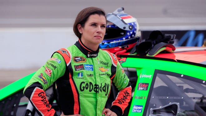 Danica Patrick stands by her car after qualifying for Sunday's NASCAR Sprint Cup series auto race at Michigan International Speedway, Friday, June 12, 2015, in Brooklyn, Mich.