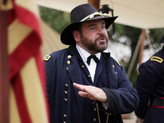 A Civil War re-enactor, portraying Ulysses Grant ,explains his war strategy Sept. 26, 2015, during the Civil War Weekend at the Wade House Historic Site in Greenbush.