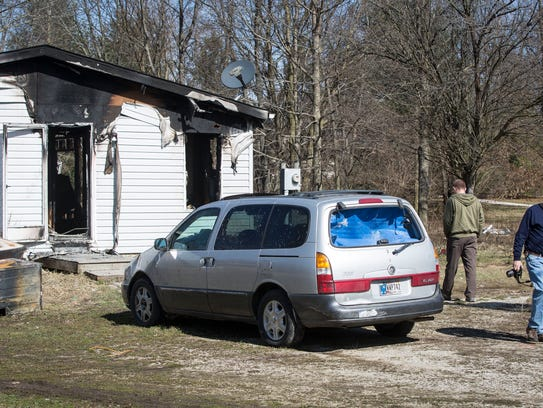 Investigators from State Fire Marshall and the Liberty