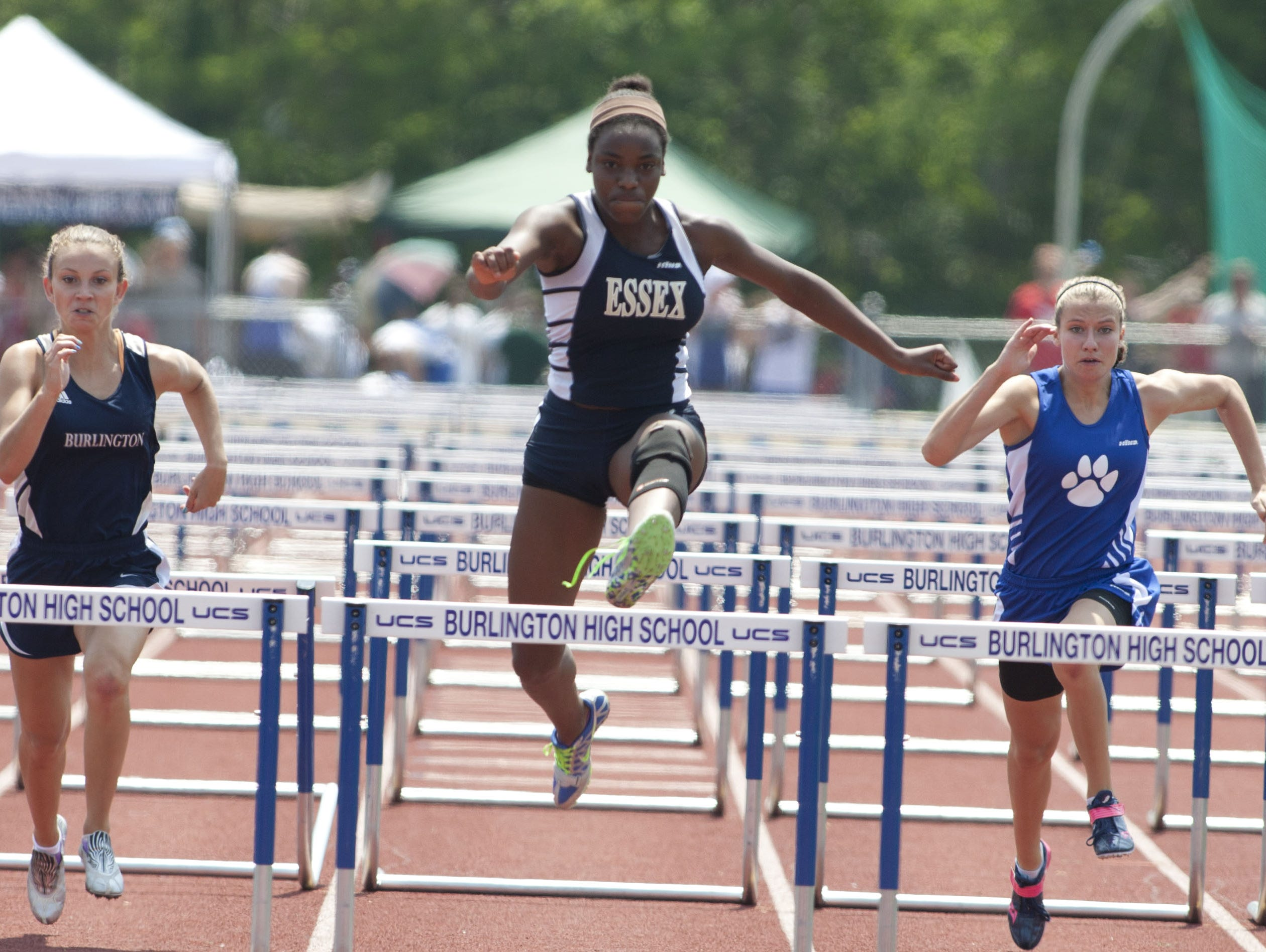 The Essex High School girls track and field program produces a bevy of high-point scorers and individual state champions, like in the 100 hurdles, which Mariah Neverett, center, won at the 2013 Division I state meet.
