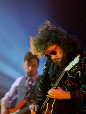 My Morning Jacket's  Jim James, right, and Tom Blankenship perform at Iroquois Amphitheater Thursday night.