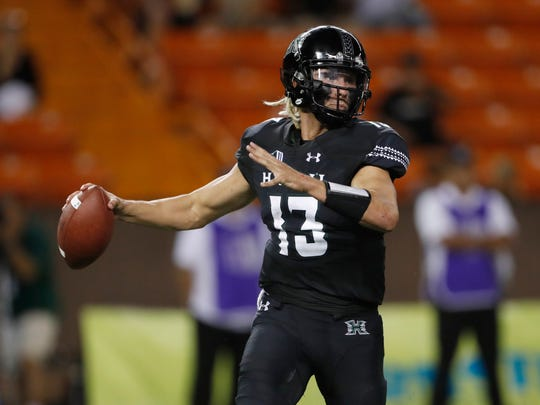 Hawaii quarterback Cole McDonald looks for a receiver during the second quarter against Rice in an NCAA college football game Saturday, Sept. 8, 2018, in Honolulu. (AP Photo/Marco Garcia)