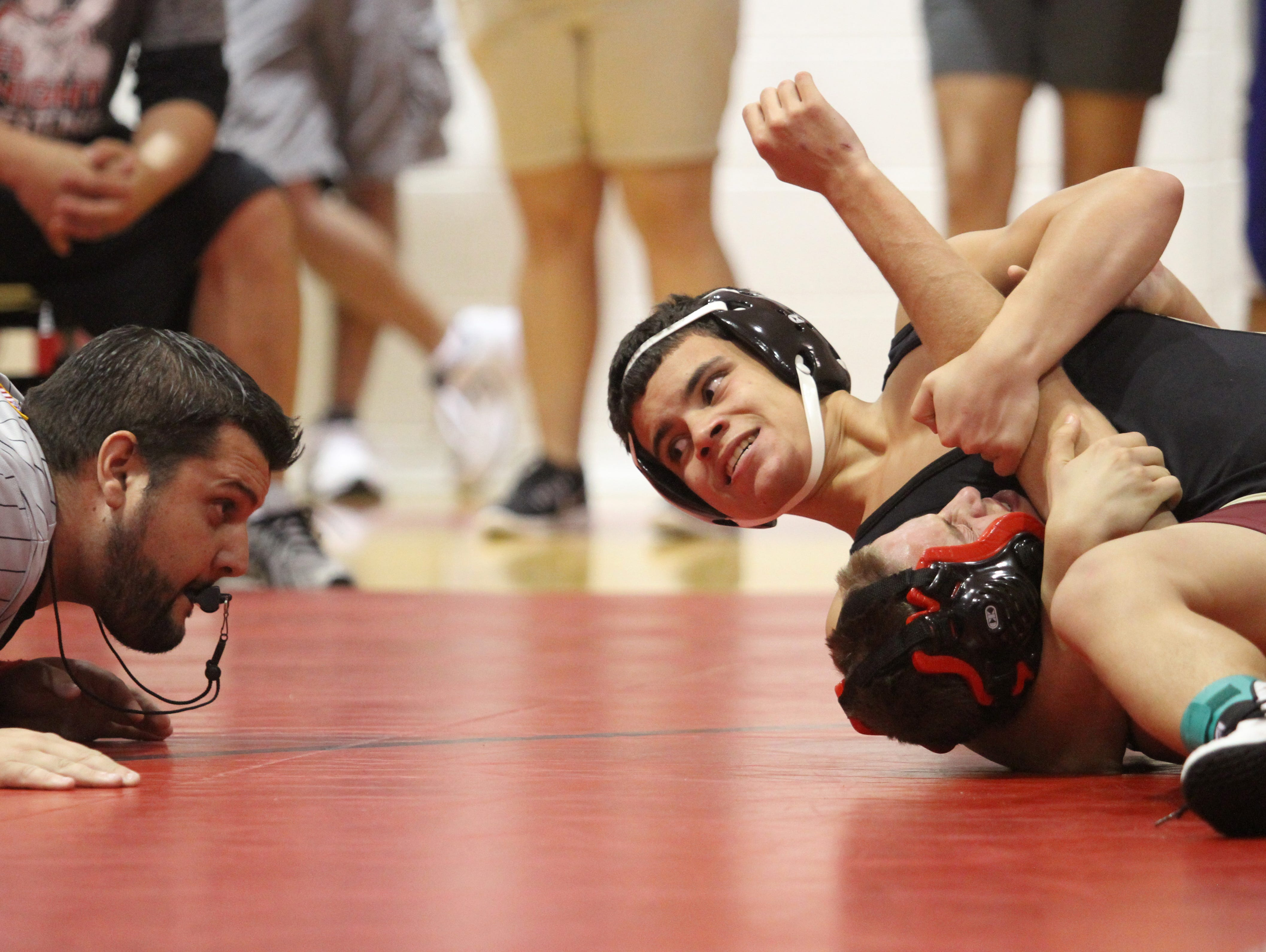 Riverdale's Jalen Santiago pins Peter Joseph of North Fort Myers to win the 113-pound district title at the District 2A-11 Championships on Friday at North Fort Myers High School.