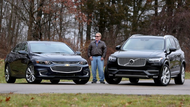 Detroit Free Press auto critic Mark Phelan with the 2016 Chevrolet Malibu and the 2016 Volvo XC90. They are his picks as the 2016 Detroit Free Press car and truck of the year.