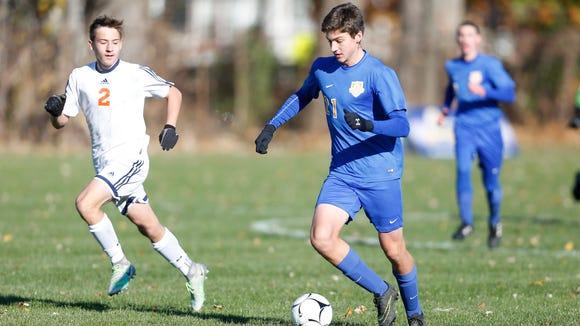 North Salem's Michael Dutt (21) advances the ball during