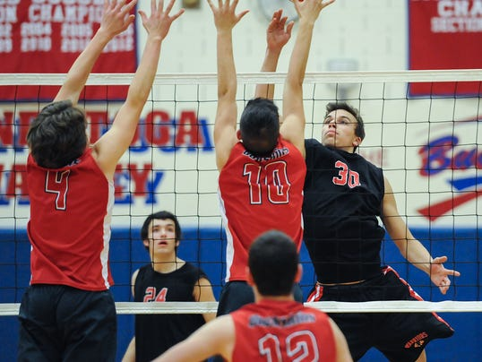 Warwick's Nate Miller elevates to tap a ball out of the reach of Conestoga Valley's Justin Gorsuch and Preston Gaines at Conestoga Valley High School on Tuesday, April 21, 2015. The Warriors won 3-1. Patrick Blain For GameTimePA.com