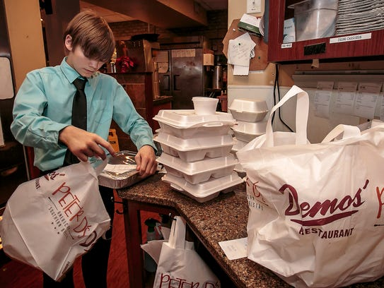 Ethan Steidinger prepares to-go orders for customers