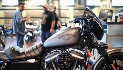 Harley-Davidson motorcycles are offered for sale at