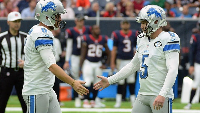 Detroit Lions kicker Matt Prater (5) is congratulated by teammate Sam Martin (6) after hitting a field goal against the Houston Texans during the first half of an NFL football game Sunday, October, 30, 2016, in Houston.