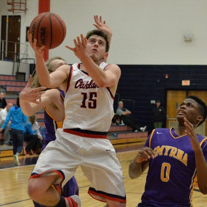 Oakland's Cooper Baughn goes to the basket as Taylor