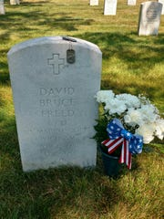 Sgt. Major Eddie Neas visits the grave of Lance Corporal
