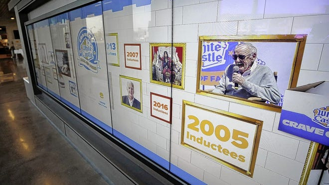A scrolling wall with all the members of White Castle's Cravers Hall of Fame is one of the interactive features at the company's new headquarters at 555 Edgar Waldo Way in Columbus. Visitors can touch the photos to find out more about the hall-of-famers. White Castle is celebrating its 100th anniversary in 2021, and the fast-food chain also will induct its 20th Cravers Hall of Fame class.