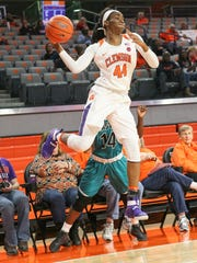 Clemson freshman Kobi Thornton saves a ball from going out of bounds during the fourth quarter on Friday at Littlejohn Coliseum.