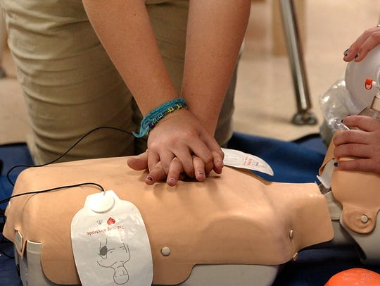 A Lafayette High health careers academy student practices CPR on a mannequin. A second health academy at Northside High is struggling with low enrollment. The Lafayette High program is at capacity.