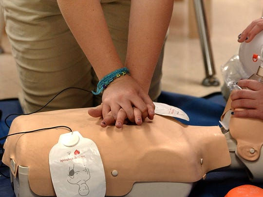 A Lafayette High health careers academy student practices CPR on a mannequin. Officials are considering a second health academy site.