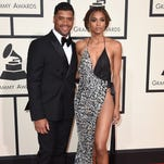 FILE - In this Feb. 15, 2016 file photo, Seattle Seahawks quarterback Russell Wilson, left, and singer Ciara arrive at the 58th annual Grammy Awards  in Los Angeles. A representative for Ciara confirms that the couple are engaged. Russell posted a video on his Facebook page Friday, March 11, 2016, showing himself next to Ciara, who was wearing a bright ring.