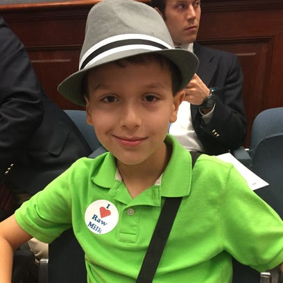 Eli Hunter, 9, of Lafayette, supported Sen. Eric LaFleur's raw milk bill in the House Agriculture Committee Thursday.