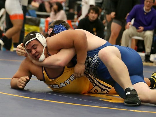 North Mason's Nico Ramirez (right) tries to turn Rogers's Markus Robinson during their 285-pound match at the HammerHead Invitational wrestling tournament at the Kitsap Sun Pavilion on Saturday.