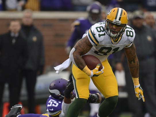 Green Bay Packers tight end Andrew Quarless (81) eludes