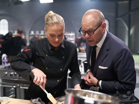 """Iron Chef Gauntlet"" host Alton Brown with Chef Jeanie Roland of Punta Gorda's The Perfect Caper."