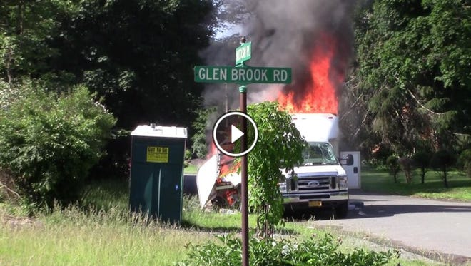 A screenshot of a plumber's van that burned after a propane or acetylene tank inside exploded on Glen Brook Road in Wesley Hills on Wednesday, June 10, 2015. A plumber was burned on the face and arms.