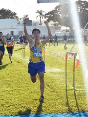 Top overall and boys division winner, Takehiro Murai of the Christian Academy of Japan, took overall honors with his 17 minute, 41.7 second finish at the API Cross Country Championships held Friday Oct. 20, 2017,  at John F. Kennedy High School. Behind him are Leonardo A'DeLima of St. Mary's International School, left and Declan Falls of the American School in Japan. CAJ won the boys team title over ASIJ.