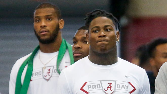 Alabama linebacker Reuben Foster stands with teammates O.J. Howard, left, and Eddie Jackson, center, during Alabama's pro day, Wednesday, March 8, 2017, at the Hank Crisp Indoor Facility in Tuscaloosa, Ala.