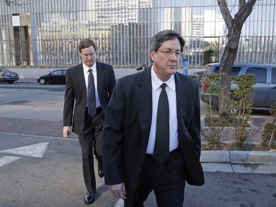 In this  Jan. 21, 2015 photo, polygamous church prophet Warren Jeffs' brothers, Lyle, foreground, and Nephi, leave a federal courthouse in Salt Lake City.