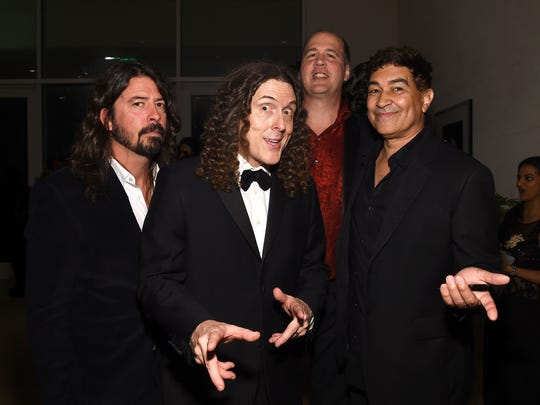"(Left to right) Musicians Dave Grohl, ""Weird Al"" Yankovic, Krist Novoselic, and Pat Smear attend the Pre-Grammy Gala and Salute to Industry Icons at The Beverly Hilton Hotel in Los Angeles earlier this year."
