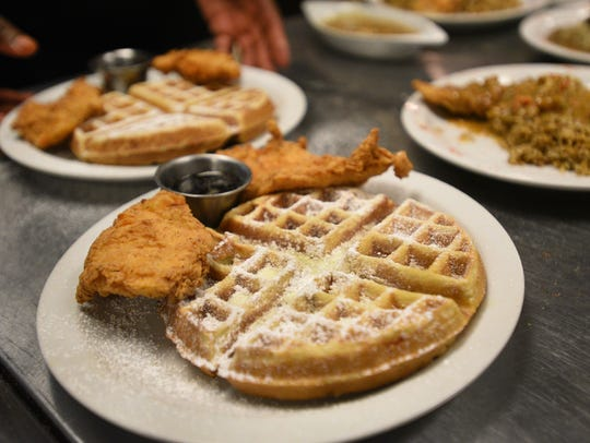 Chicken and waffles prepared by Crescent City Bistro