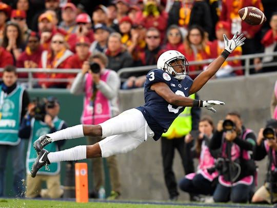 Penn State's DeAndre Thompkins can't quite haul in a pass earlier in his career. Like most of PSU's receivers this season, Thompkins has struggled with dropped passes. AP FILE PHOTO