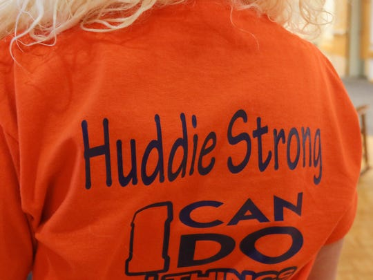 Kaci Belviso, of Spartanburg, wears a Huddie Strong t-shirt on Thursday at the Shriners Hospitals for Children in Greenville. Her son Hudson Belviso had a leg amputated earlier in the morning.