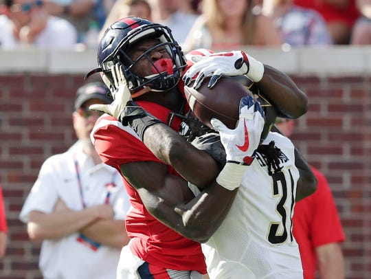 Mississippi wide receiver D.K. Metcalf (14) pulls in