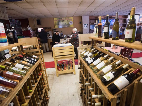 Customers shop for food, wine and beer at City Grocery