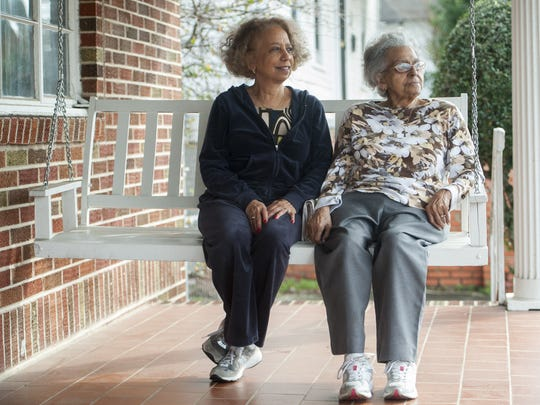 Valda Montgomery and her mother Vera Harris sit on the front porch of their family home in Montgomery.