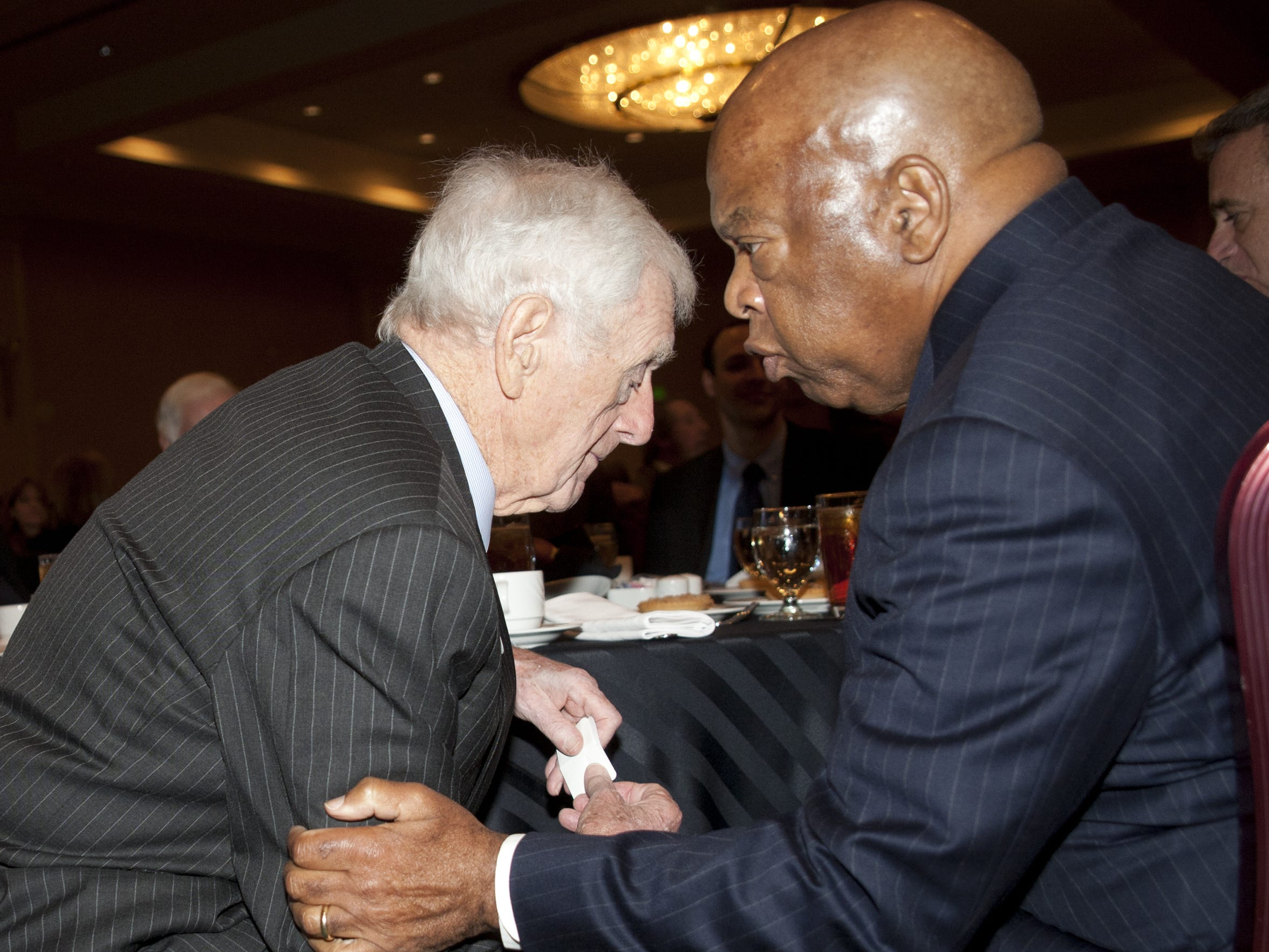 John Seigenthaler, left, and U.S. Rep. John Lewis of Georgia talk at a Community Foundation of Middle Tennessee luncheon Nov. 8, 2012, at the Renaissance Hotel. Seigenthaler was honored with the Joe Kraft Humanitarian Award.