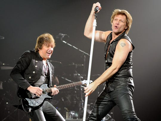 Bon Jovi guitarist Richie Sambora (L) and singer Jon Bon Jovi perform at the MGM Grand Garden Arena March 19, 2011 in Las Vegas.