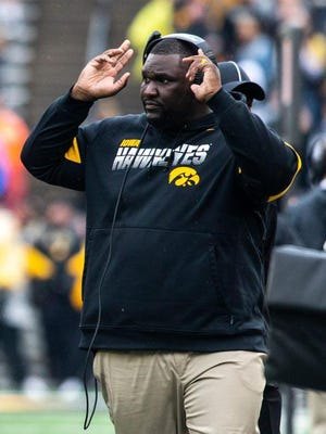 Iowa defensive line coach Kelvin Bell calls out to players during a game between the Iowa Hawkeyes and Purdue Oct. 19 at Kinnick Stadium in Iowa City.