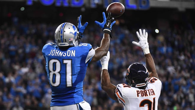 Detroit Lions wide receiver Calvin Johnson (81) catches a touchdown pass against the Chicago Bears during the fourth quarter at Ford Field.