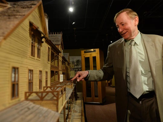 Jim Meinert, executive director of The History Museum, stands next to a scale model of the Park Hotel on display as part of the museum's Downtown Great Falls exhibit.