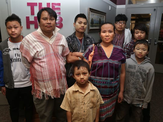 Dee Htoo and wife Paw Moo are Burmese refugees who arrived in Des Moines with their children six months ago. They <137>in Des Moines, Iowa and <137>live pretty isolated lives because of cultural differences. Days of worship at Creekside Church give them a place to find community and socialize. Here, they are shown in the church lobby with their children on March 30.
