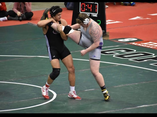 Genoa's Noah Koch, left, finished third at the state
