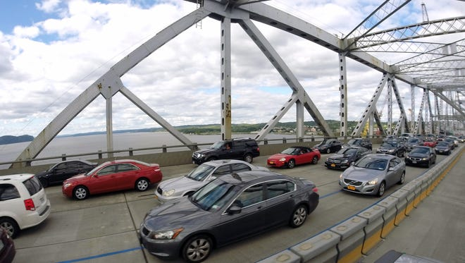Commuters cross the Hudson River on the Tappan Zee Bridge on Aug. 27, 2015, as construction continues for the new bridge.